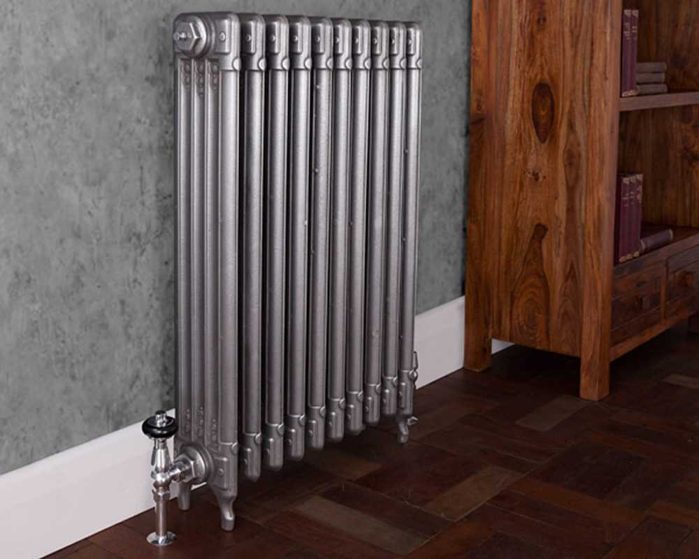 Deco cast iron radiator hand burnished in period property