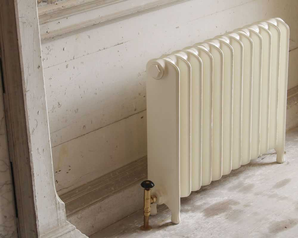 Eton 1 column cast iron radiator painted in buttermilk with brass valve