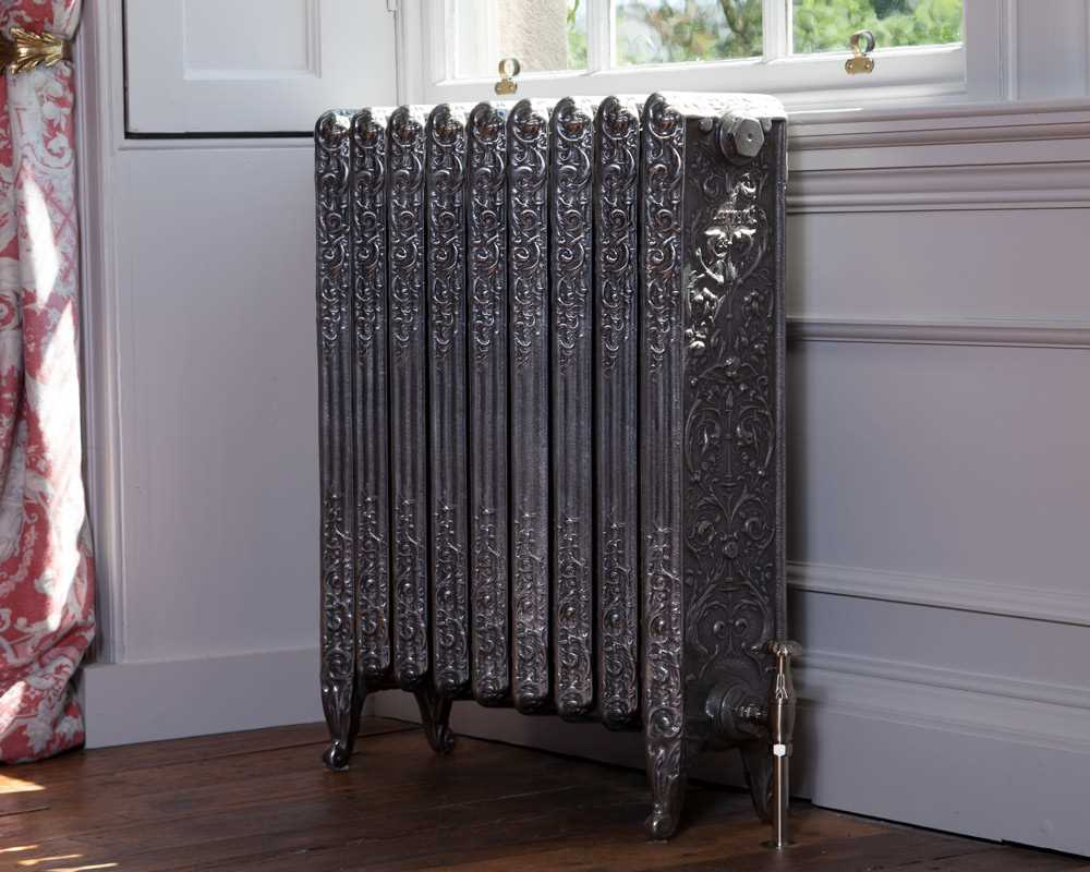 hand burnished Veneto cast iron radiator with satin valve in period house