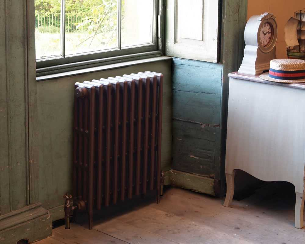victorian painted column radiator under window in period property