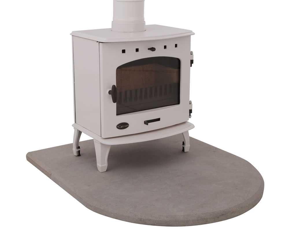 curved sandstone hearth with cast iron stove in cream